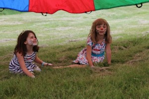 Lucy, Margaret, parachute and painted faces. All fun.